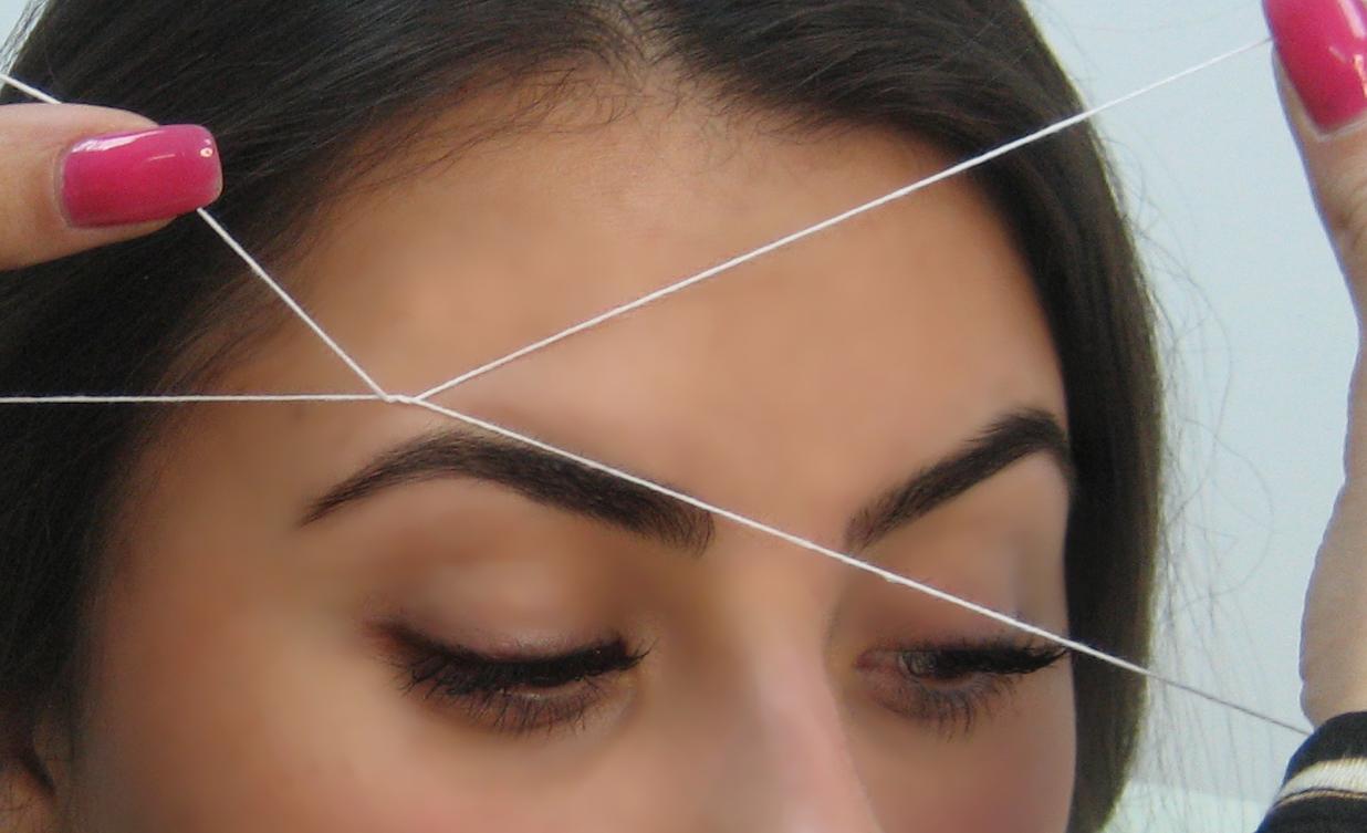 Удаление нежелательных волосков с помощью нити